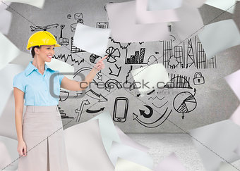 Composite image of smiling attractive architect pointing