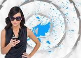 Composite image of happy brunette using smartphone