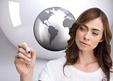 Composite image of concentrated businesswoman holding whiteboard marker