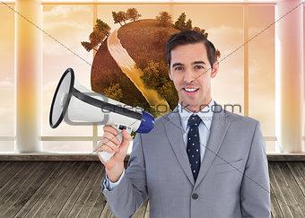 Composite image of smiling businessman holding a megaphone