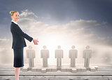 Composite image of happy businesswoman looking at camera