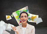 Composite image of smiling businesswoman holding a pen
