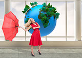 Composite image of elegant blonde holding umbrella