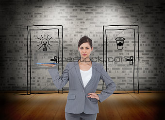 Composite image of smiling businesswoman holding tablet pc