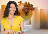 Composite image of smiling casual young woman scrolling on her tablet computer