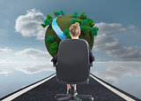 Composite image of businesswoman sitting on swivel chair