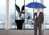 Composite image of businessman smiling at camera and holding blue umbrella