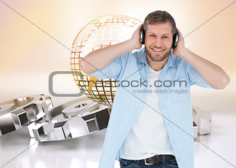 Composite image of trendy model listening to music and looking at camera