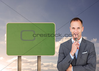 Composite image of smiling businessman holding glasses