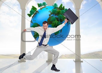 Composite image of cheerful jumping businessman with his suitcase