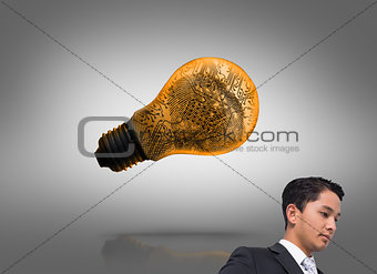 Composite image of unsmiling asian businessman