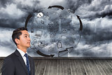 Composite image of graphic on wall with stormy sky