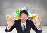 Composite image of smiling asian businessman holding hands up