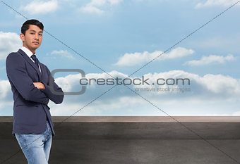 Composite image of unsmiling casual businessman with arms crossed