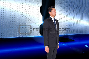Composite image of stern businessman looking away