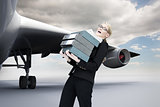 Composite image of businesswoman carrying folders