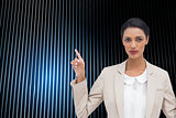 Composite image of serious businesswoman with hands up