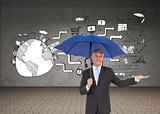 Composite image of peaceful businessman holding blue umbrella