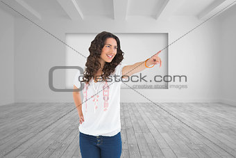 Composite image of cheerful attractive brunette wearing casual clothes pointing