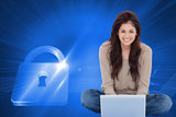 Composite image of woman sitting on the bed with the laptop in front of her and smiling