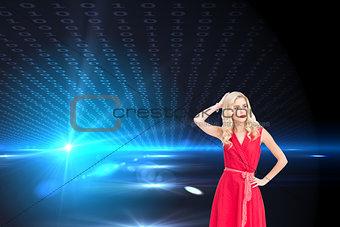 Composite image of elegant blonde standing hand on hip