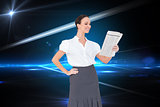Composite image of cheerful stylish businesswoman holding newspaper