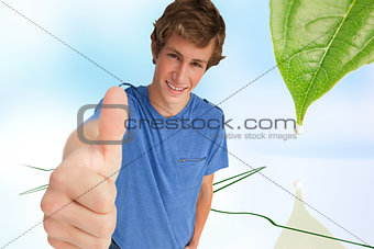 Composite image of fisheye view of a male student the thumb-up