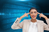 Composite image of confident young businesswoman pointing her head with her fingers