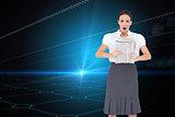 Composite image of shocked stylish businesswoman holding newspaper