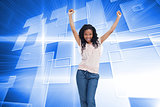 Composite image of a young happy woman stands with her hands in the air