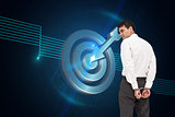 Composite image of businessman wearing handcuffs