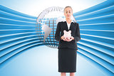 Composite image of businesswoman holding pink piggy bank