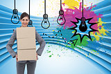 Composite image of smiling businesswoman carrying cardboard boxes