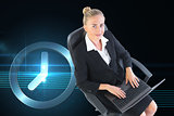 Composite image of businesswoman sitting on swivel chair with laptop
