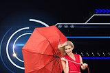 Composite image of smiling blonde holding umbrella