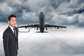 Composite image of unsmiling businessman looking at camera