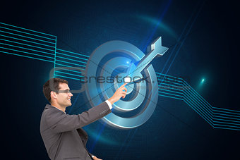Composite image of smiling classy businessman sitting and pointing