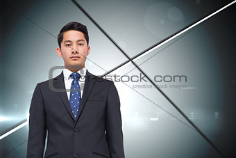 Composite image of stern businessman looking at camera