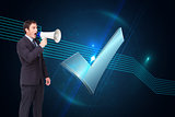 Composite image of standing businessman shouting through a megaphone