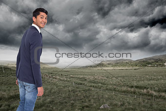 Composite image of smiling casual businessman walking