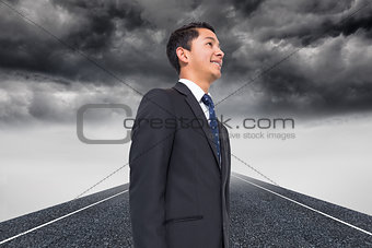 Composite image of stormy landscape background with street