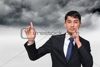 Composite image of thoughtful businessman touching