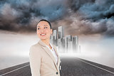Composite image of smiling asian businesswoman