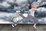Composite image of happy classy businesswoman jumping while holding smartphone