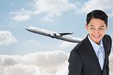 Composite image of smiling asian businessman