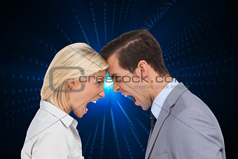 Composite image of colleagues quarreling head against head