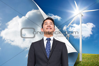 Composite image of sky background over turbine background