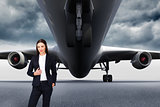 Composite image of portrait of a confident businesswoman standing