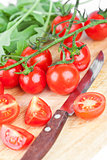 fresh tomatoes, rucola and old knife