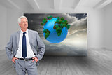 Composite image of man in a suit with his hands on his hips